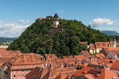 The Schlossberg (Castle Hill) with the Uhrturm (Clock Tower), the iconic landmark of Graz, from the Townhall Graz Austria, Beautiful Places To Travel, Future Travel, Heritage Site, In The Heights, Monument Valley, Germany, Around The Worlds, City