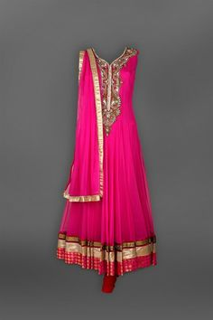 Pink Net Anarkali - Featuring a pink net anarkali with crystal &dabka hand embroidery on neckline. Brocade & lace borers on ghera & dupatta.