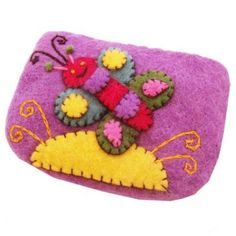 £6.00 Fair Trade felt purse from Nepal - with cute butterfly design and clever stitching.  Take a closer look... http://www.thefairtradestore.co.uk/fair-trade-children-s-gifts/felt-purse-lilac-with-butterfly/prod_661.html  #Felt #Butterfly #Craft #Children #Nepal