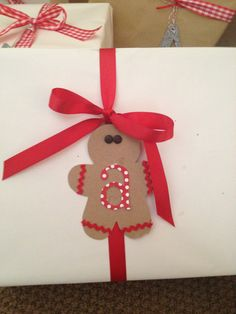 DIY gingerbread man wrapped Christmas gifts