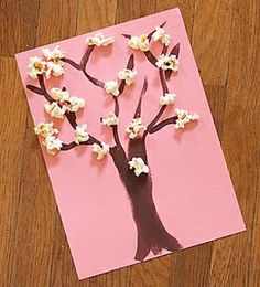 We found this fantastic cherry blossom project at PreschoolRock.com {via Evelyn Saenz's Squidoo page}. What child wouldn't like working with popcorn?!  Supplies You'll Need    Pink construction...