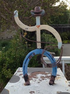 cowboy decoration on a mailbox, made of horseshoes. photo by sari f.