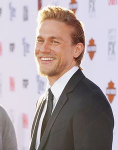 Charlie was all smiles at the Sons of Anarchy premiere in LA in | Charlie Hunnam's Superhot Hollywood Evolution in 35 Photos | POPSUGAR Celebrity