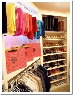 Organized closet and built-in shoe shelves with boots on top.