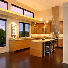 Dark floors with med oak cabinets and light kitchen quartz
