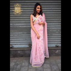 Floral blouse with floral peticoat and net Saree with gold lace border .