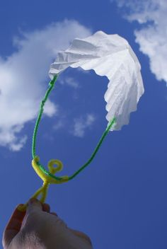 Here's a simple craft to get your kids playing outside--parachute guys, made from fuzzy sticks and a coffee filter.