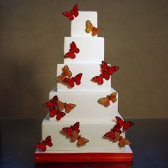 Scattered butterflies wedding cake