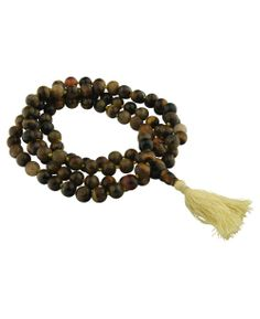 Tiger Eye meditation mala beads, made in India. Meditation supplies available at BuddhaGroove.com.
