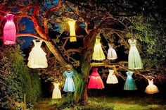 EASY-PEASY: DRESSES BOUGHT FROM GOODWILL, LIT AND HUNG IN THE TREES. The Domestic Curator: FUN OUTDOOR HALLOWEEN DECOR