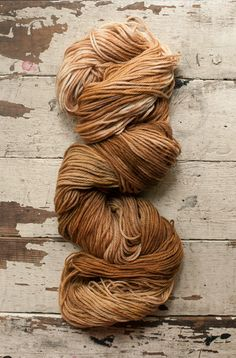 Merino Worsted Yarn: hand dyed with cutch and walnut hulls in shades of caramel and rich, coppery brown. by Camellia Fiber Co.