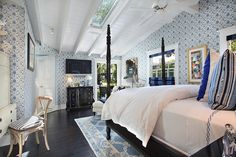 everything about this - bed, high ceiling, light, space, shape, colors, patterns, windows, art, rug