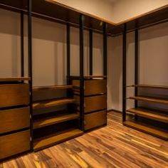 Vestidor / Recámara principal: Vestidores y closets de estilo Moderno por BANG arquitectura