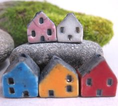 Hand formed miniature house beads. Stamped windows and doors. Low fire glazes on the walls. Unglazed (smoked) roofs. elukka on Etsy