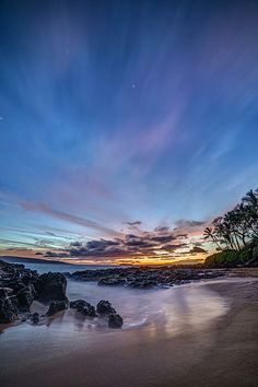 secret cove, on the tropical island of maui, hawaii at twilight with a heart shape in the clouds