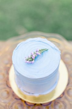 Lavender rustic buttercream cake for a farm styled shoot. Photo by Lauren Buman photography, cake by sift bakehouse out of Phoenix, Arizona.