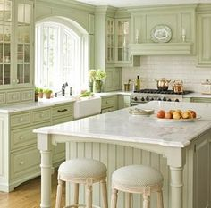Soft green and white palette, white marble countertops with gray veining by alison