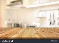 Wood Table Top (As Kitchen Island) On Blur Kitchen Interior Background - Can Be Used For Display Or Montage Your Products Stock Photo 410535943 : Shutterstock