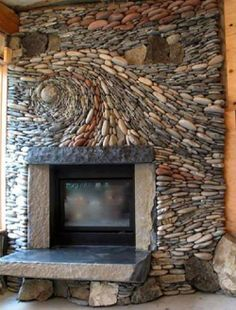 River rock fireplace...new & awesome twist on an old not-so-favorite.  Love this!