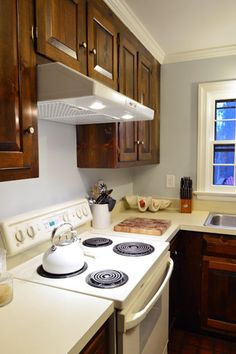 Switch a hanging microwave for a sleek range hood (ours was $25 on Craigslist!)
