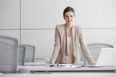 Stock Photo : Portrait of confident businesswoman in conference room