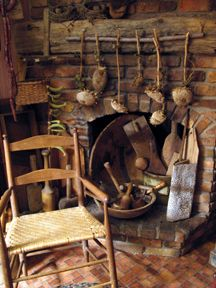 Very hobbity: however the fire place is a focal point in a country home. So no matter the condition of the fireplace, always include things around the FP that pertain to it's use and it brings the warmth back in. Include rustic iron, tea pot, old or new wooden spoons, fire pokers, dry herbs around the FP, roast nuts, favorite tins of tea to go with your teapot etc.