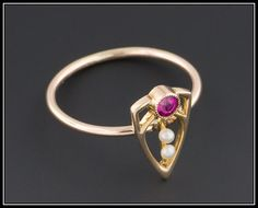 ***** SOLD to C. - Please Do Not Purchase Unless You are C. *****  Total Price: $335 Balance Due: $0  A lovely 10k gold, ruby, and pearl ring!  The 10k gold top of this ring was originally part of an antique stick pin (circa 1910) that we transformed into this fabulous ring by removing the pin stem and adding a 10k gold band. The top of the ring measures 0.5 inches (13mm) tall by 0.3 inches (8mm) wide and the condition is excellent. This ring is currently a size 6, but most of our rings can…