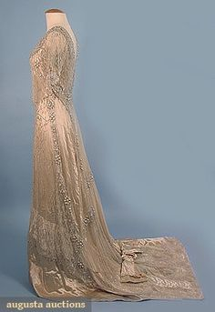 """1-piece cream silk satin w/ heavily beaded white tulle over-dress, also decorated w/ faux baroque pearls, B 36"""", W 27.5"""", H 38"""", front L 59"""", back L 77"""", silk petersham labeled """"Frederick Loeser Brooklyn"""""""