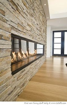 Fireplace wall, mixed gray stone/tile with built ins on either side. Like the stone work.