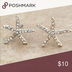 Gold Tone Crystal Starfish Beach Nautical Studs Gold tone nautical beach theme stud earrings feature starfish set with glittering clear crystals.  Posts with friction backs complete the look.  Earrings measure 5/8 inch L x 3/4 inch W. Jewelry Earrings