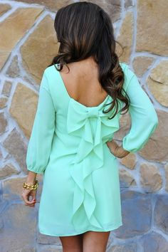 mint green bow back dress with ruffle.