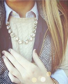Blue gingham undershirt, white cable knit sweater, gray puffer vest, sparkly necklace