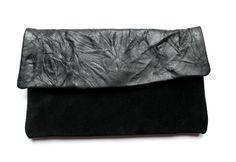 black leather wallet by nastya klerovski