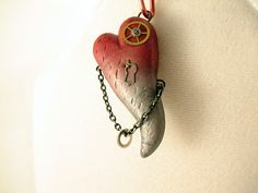 http://www.etsy.com/listing/90746637/steampunk-polymer-clay-heart-pendant by PCharmingThings, $17.00