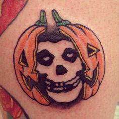 misfits band logo inside pumpkin head tattoo