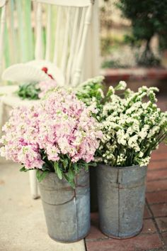 i loved the galvanized french buckets with florals at my wedding....would do that all over again