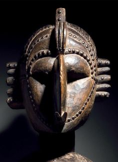 Africa | Detail from a 'Nimba' shoulder mask from the Baga people of Guinea | Wood; with dark brown and black patina. Decorated with brass tacks / nails. | Late 19th to early 20th century
