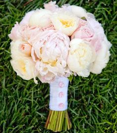Bouquet of garden roses and peonies in pale shades of pink, ivory, and butter yellow. - i would like white calla lillies in as well