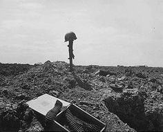 After securing the beach fellow soldiers erected this monument to an american soldier somewhere on the shell-blasted coast of Normandy 1944. Photo: Flickr / The U.S. Army.