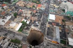 Guatemala City Sinkhole, 5/31/10: Thought to be due to torrential rains from tropical storm Agatha was estimated to be 60'wide and 300' deep. via csmonitor #Sinkhole #Guatemala_City