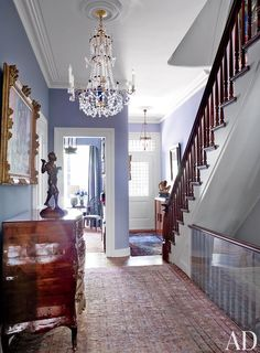 Robert Duffy's Historic Manhattan Townhouse - The entry hall includes a large Swedish cut-glass chandelier and an Italian parquetry commode, both century. Love the lavender walls Foyer Decorating, Interior Decorating, Interior Design, Decorating Ideas, Decor Ideas, Foyer Ideas, Luxury Interior, Architectural Digest, Home Design