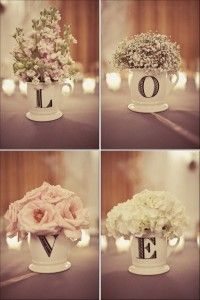 flowers in letter mugs- good to have mugs instead of lots of vases to give away to guests at the end of the night!