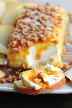 8 oz cream cheese, caramel sauce,  (homemade or store bought) toffee bits. Sliced apples, pears, pretzels, for serving. Place cream cheese on a service dish. Pour evenly as much caramel sauce as you want over cream cheese. sprinkle w/generous helping of toffee bits. Serve with above fruits or pretzels.
