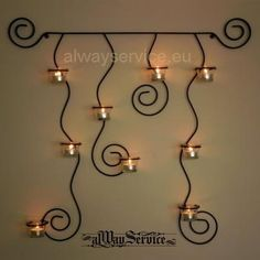 Wrought iron candle holder, price: 20.46Euro Handmade. Complete with 9 items glass candle cups. Dimensions: 70x70x10sm.  Shop online at: www.alwayservice.eu