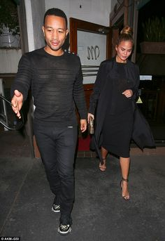 Pecs appeal:Chrissy lovingly cradled her baby bump as she left the Hollywood eaterie after a romantic night out with her hubby on Friday night