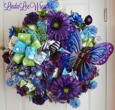 Wreath in vibrant purples, blues and greens.Butterfly Wreath in vibrant purples, blues and greens. Wreath Crafts, Diy Wreath, Wreath Ideas, Grapevine Wreath, Summer Crafts, Diy And Crafts, Summer Wreath, Spring Wreaths, Deco Mesh Wreaths