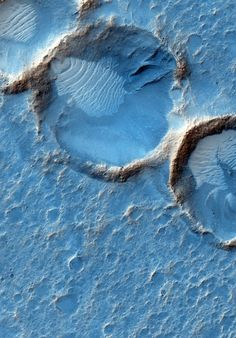 This photograph obtained by the HiRISE camera on Mars Reconnaissance Orbiter shows the aged craters and debris carried by the wind in the Acidalia Planitia. Blue tones predominate, but surely the human eye would see the . Cosmos, Space Planets, Space And Astronomy, Sistema Solar, Mars Surface, Mars Planet, Astronomy Pictures, Astronomy Facts, Planets And Moons
