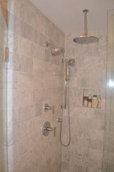 """Kitchen and Bath Remodel - Bath (After) Shower Head: Kohler, Purist  Shower Hand held: Kohler, Purist Shower Trim Levers: Kohler, Purist 10"""" Rain Shower: Moen Square Tile in Shower Drain: Kohler Tempered Glass Custom Shower Door: By Precision Glass, Malta, NY Shower Floor: Tumbled Bianco 4x4 Honed Marble Shower Threshold: Carrara Marble Marble Floor and Shower Walls: 6x18 White Venatino, Honed Carrara Marble Shower Seat: Carrara Marble"""
