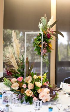 Table decoration, Flower arrangement, Orchids, Proteas, Tulips, Lisianthus, anthuriums, Classic roses, boho vibes, pampas grass, fresh flowers   Naomi Rose Floral Design