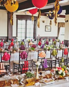 Fringed Accents  Bold-colored tassels hung on the back of each chair and oversized balloons with fringe of their own floated overhead.